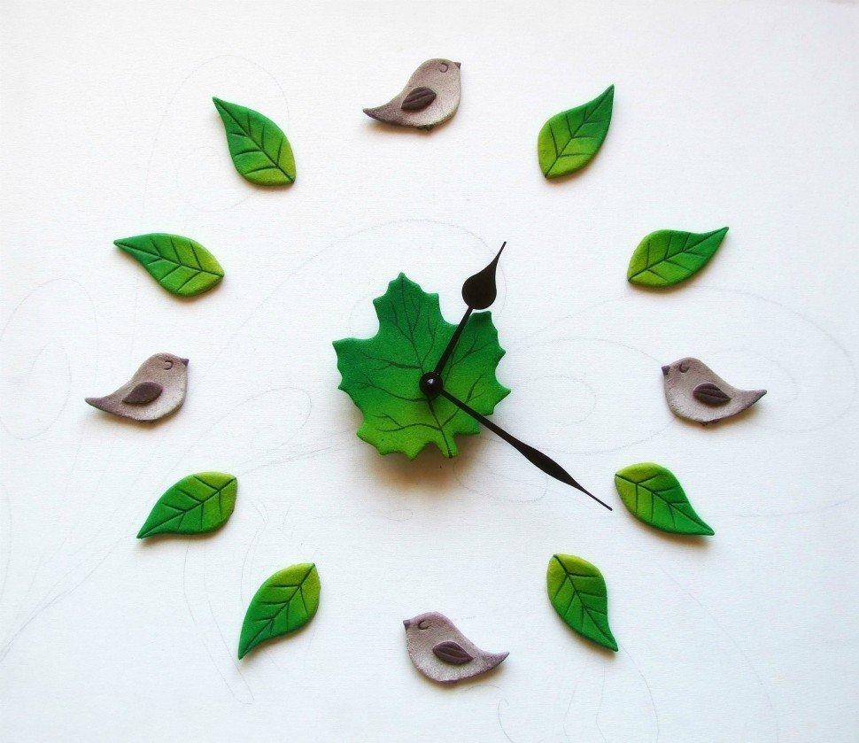 orologio da parete con uccellini